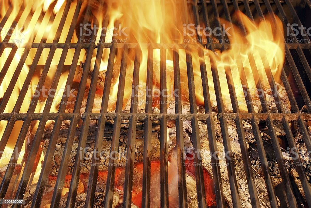 Hot BBQ Grill and Burning Charcoals with Bright Flame stock photo