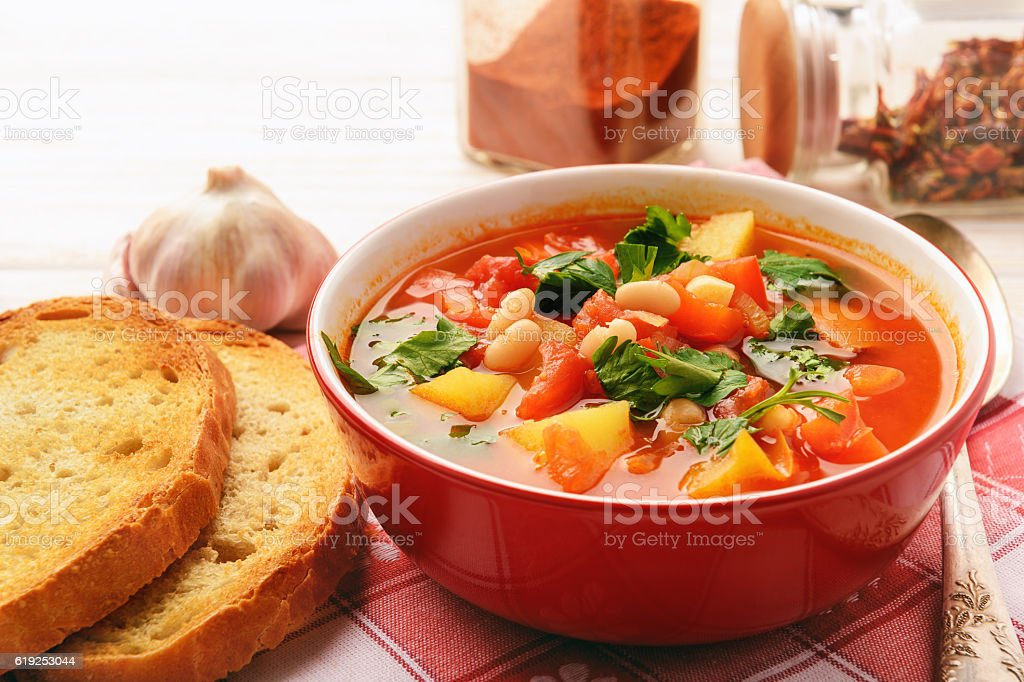 Hot bean soup with bacon and vegetables. stock photo