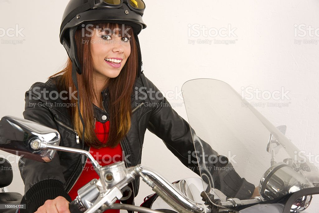 Hot Biker Chick Geared Up sitting on Motorcycle stock photo
