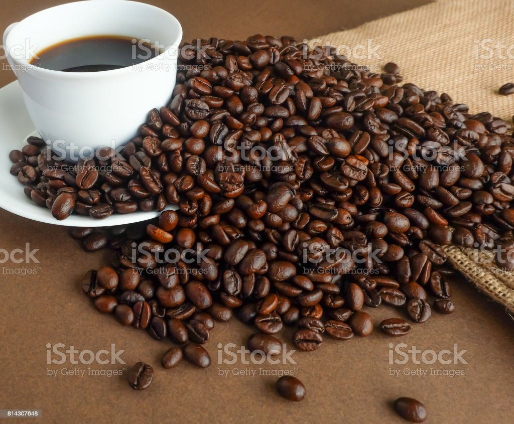 Hot black coffee and coffee roast beans. stock photo