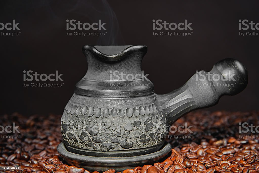 Hot black coffee in a traditional coffee pot stock photo