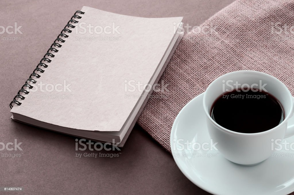 hot black coffee in a white cup and notebook. stock photo