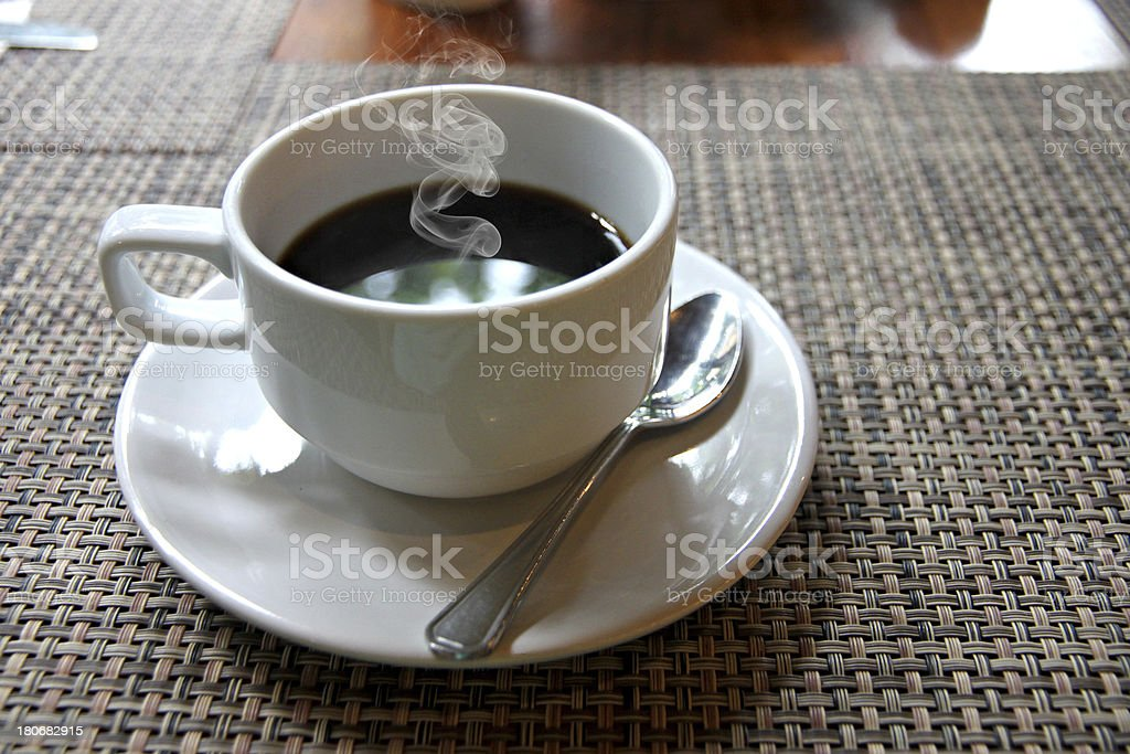 Hot Black coffee in a white cup on the table. - Royalty-free Adults Only Stock Photo