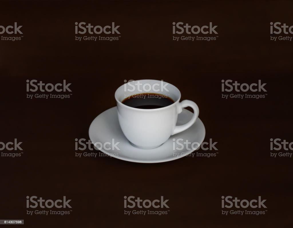 Hot black coffee on dark brown background. stock photo