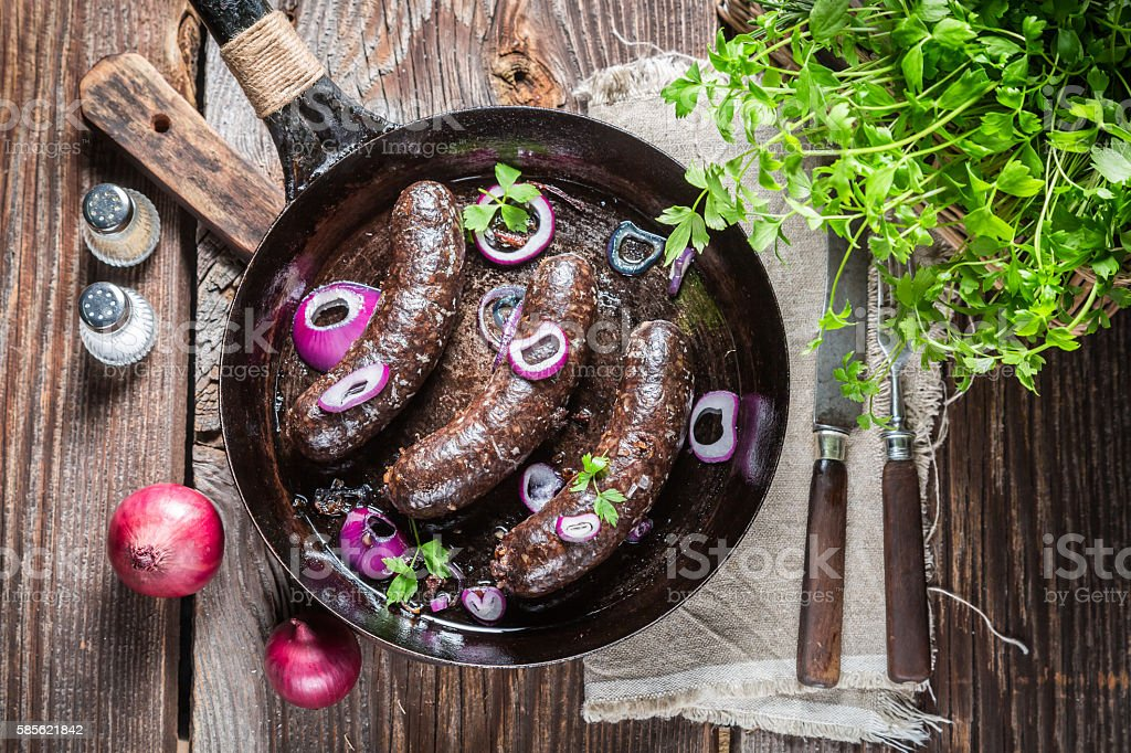 Hot black pudding with onion and parsley