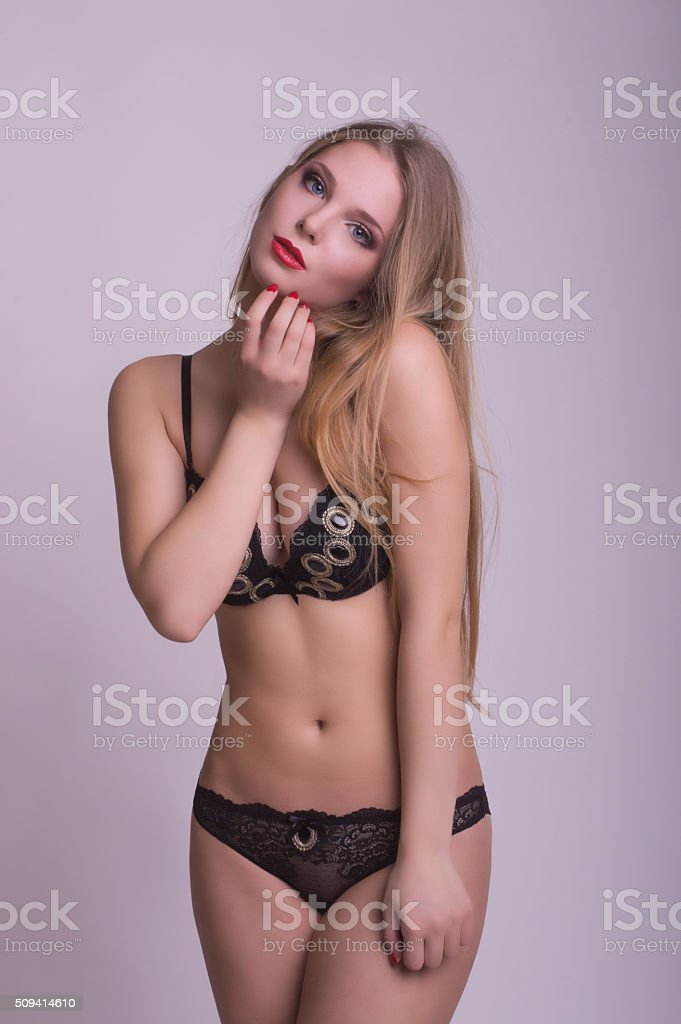 Hot Blonde Woman In Lingerie Posing In The Studio Stock Photo