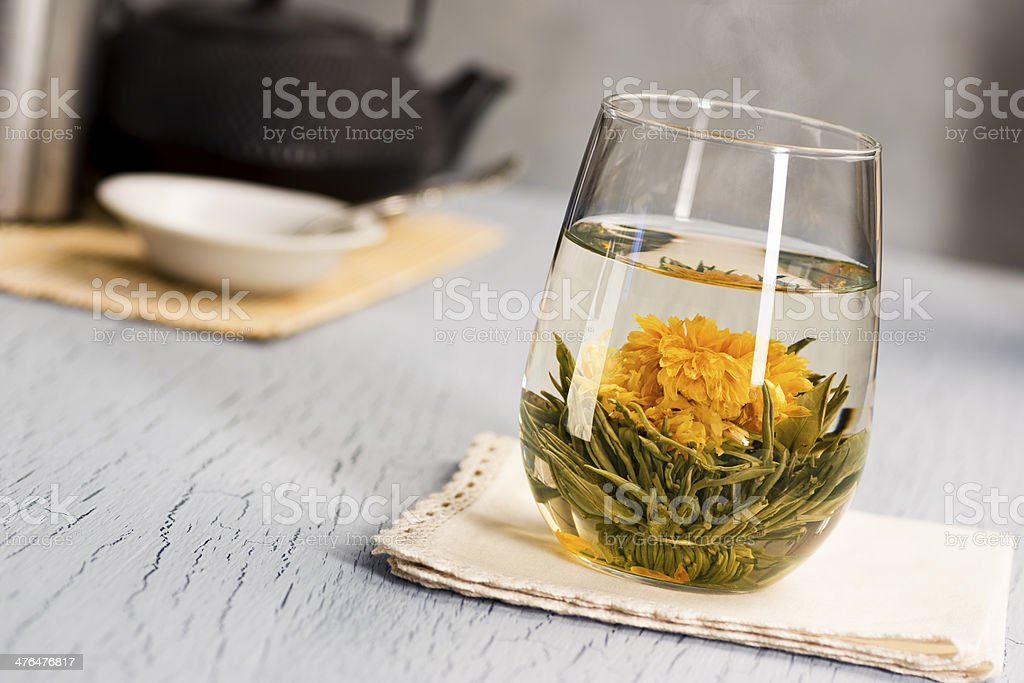 Hot Blooming Flower Tea in Glass stock photo