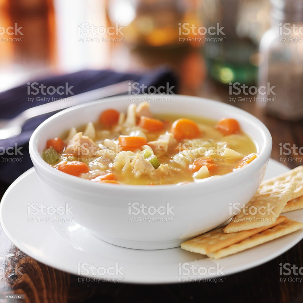 hot bowl of chicken noodle soup stock photo