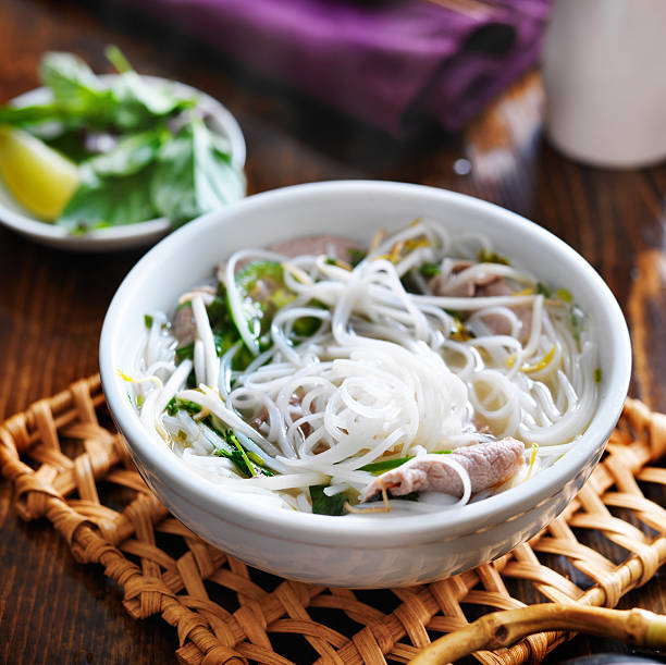 hot bowl of pho with beef and rice noodles hot bowl of pho with beef and rice noodles shot from high angle rice noodles stock pictures, royalty-free photos & images