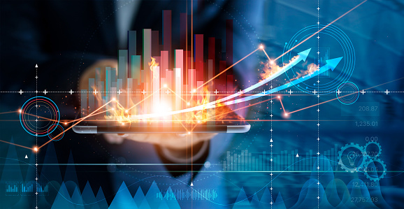1025744818 istock photo Hot business growth. Businessman using tablet analyzing sales data and economic growth graph chart. Business strategy, financial and banking. Digital marketing. 1165051903