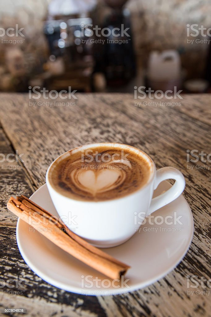 Hot cappuccino with love froth art stock photo