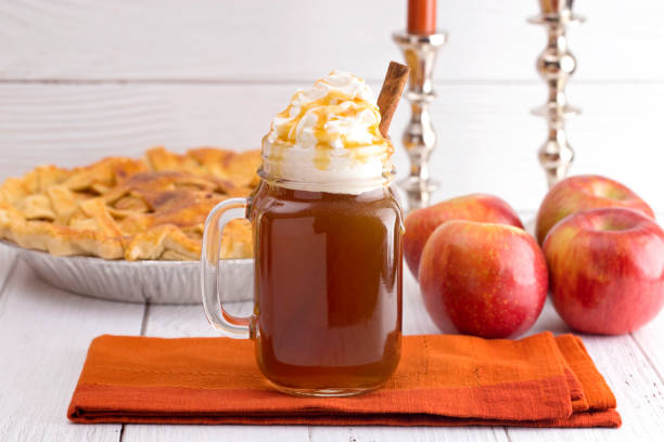 Hot Caramel Apple Cider with an Apple Pie and Cinnamon Stick Hot Caramel Apple Cider with an Apple Pie and Cinnamon Stick hot apple cider stock pictures, royalty-free photos & images