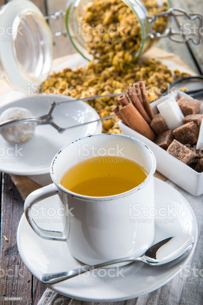 Hot chamomile tea made of wild flowers stock photo