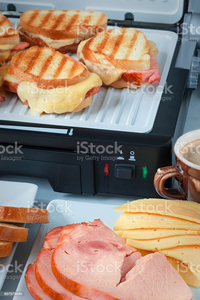 Hot cheese and ham sandwiches, cup of coffee  slices стоковое фото