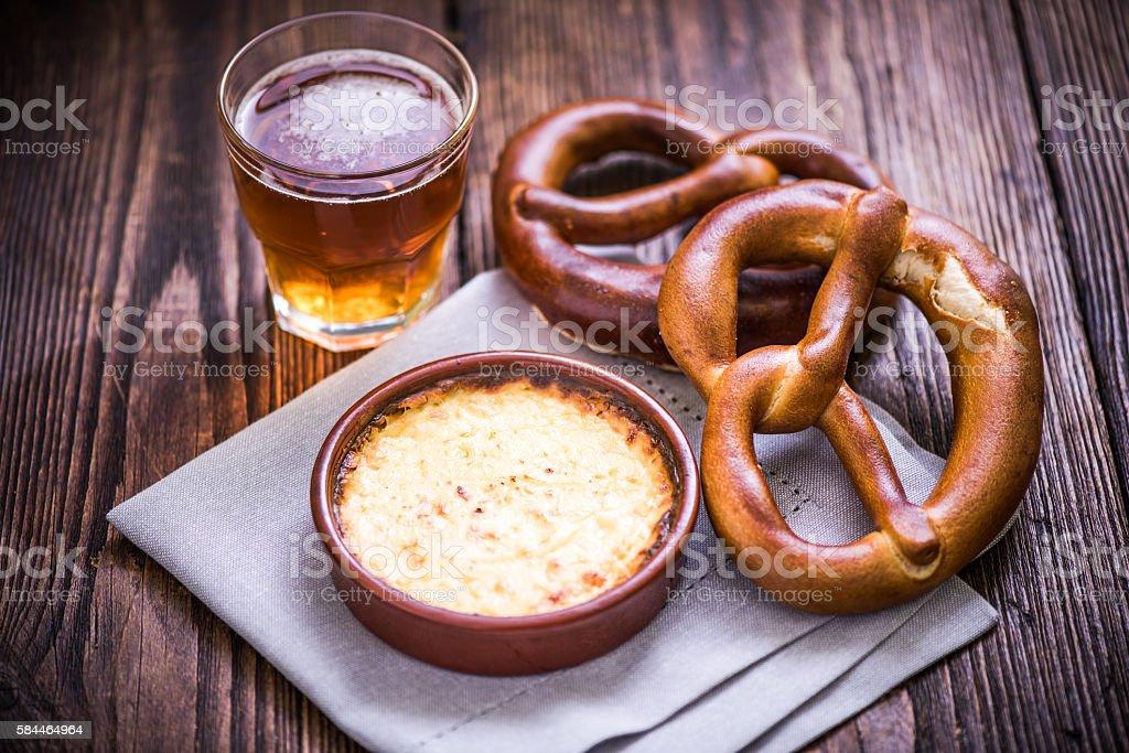 Hot cheese fondue with pretzel stock photo