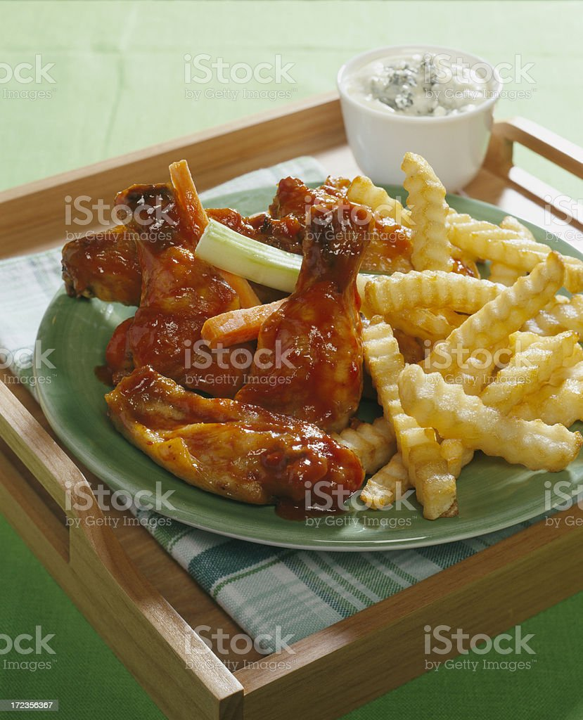 Hot Chicken wings and french fries. royalty-free stock photo