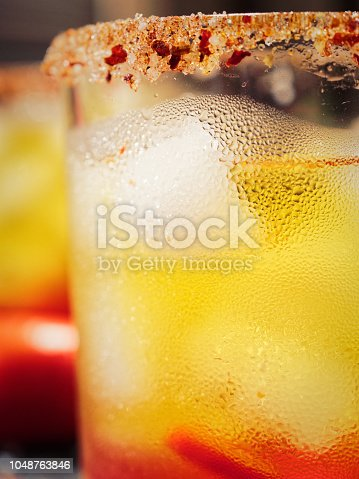 Cocktail with chili peppers based on gold tequila and fruit syrups