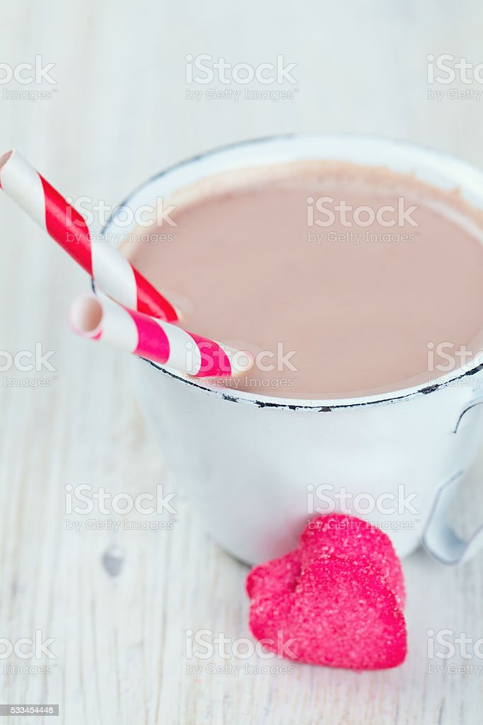 hot chocolate and heart-shaped marshmallow on wooden surface stock photo