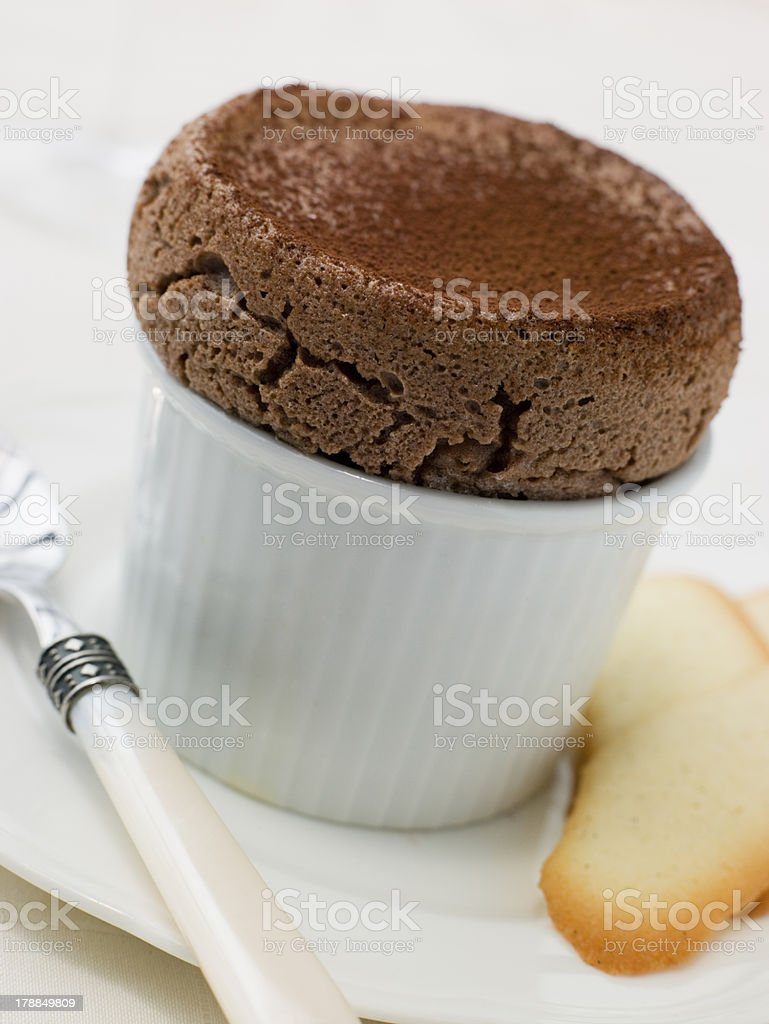 Hot Chocolate Souffle with Langue de Chat Biscuits stock photo
