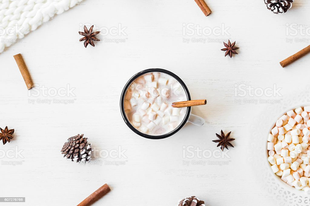 Hot chocolate, cinnamon sticks, anise star, marshmallow, knitted blanket stock photo