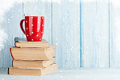 Hot chocolate cup on books