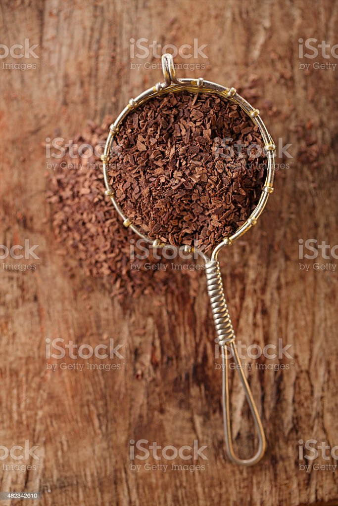 hot chocolate flakes with chilli flavor in old rustic style stock photo