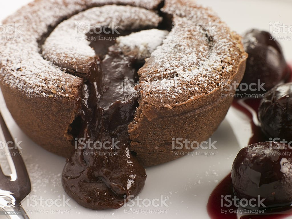 Hot Chocolate Fondant Pudding with Black Cherry Syrup stock photo