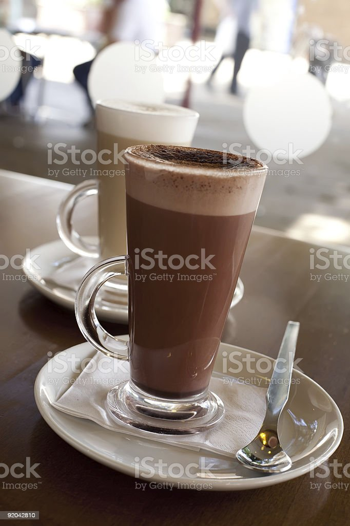 Hot chocolate in a tall class with Cafe Latte  background royalty-free stock photo