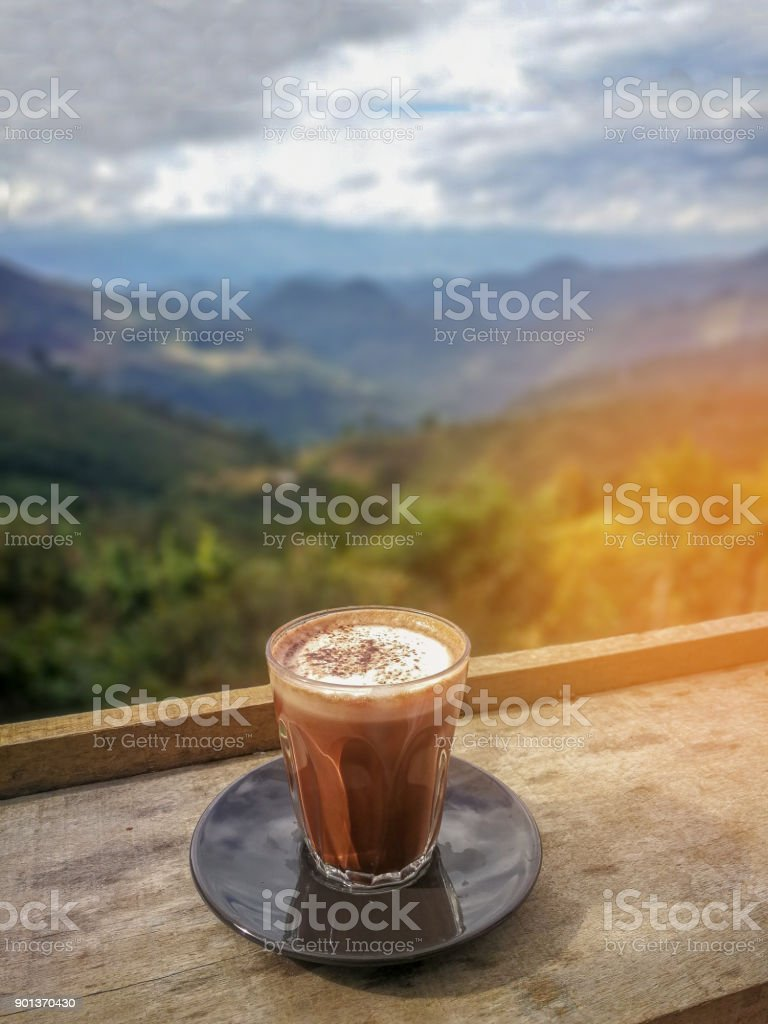 Hot Chocolate Is On A Wooden Table Background Is Beautiful Mountain