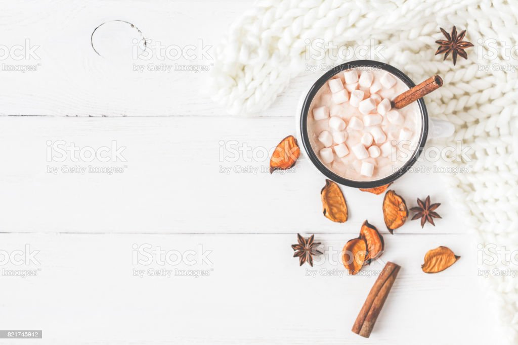 Hot chocolate, knitted blanket, autumn leaves. Flat lay, top view stock photo