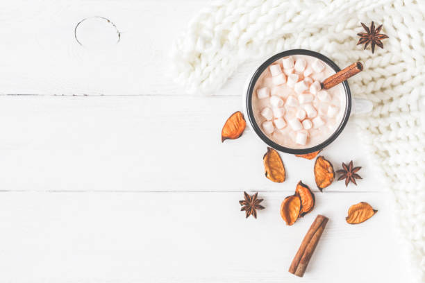 hot chocolate, knitted blanket, autumn leaves. flat lay, top view - hot chocolate stock photos and pictures