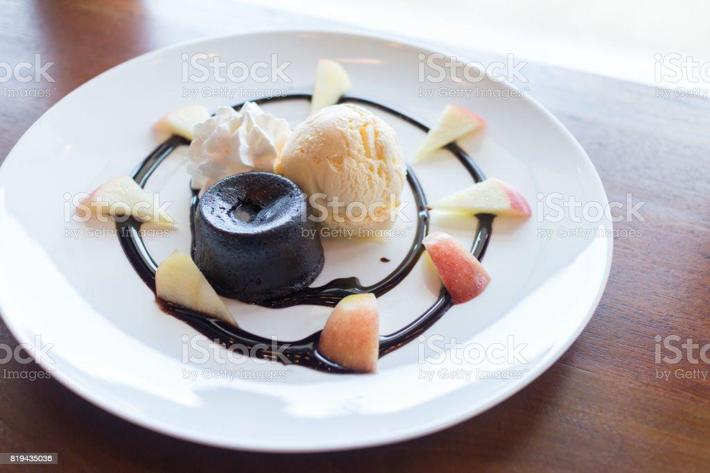 hot chocolate lava cake with vanilla ice cream ball and apple stock photo
