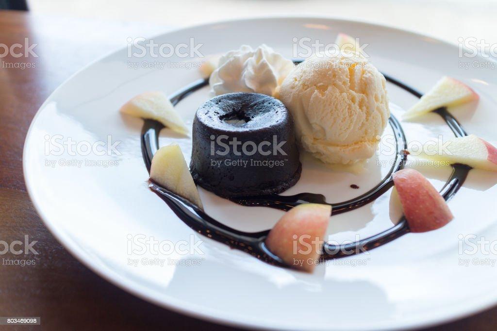 hot chocolate lava cake with vanilla ice cream ball, apple stock photo