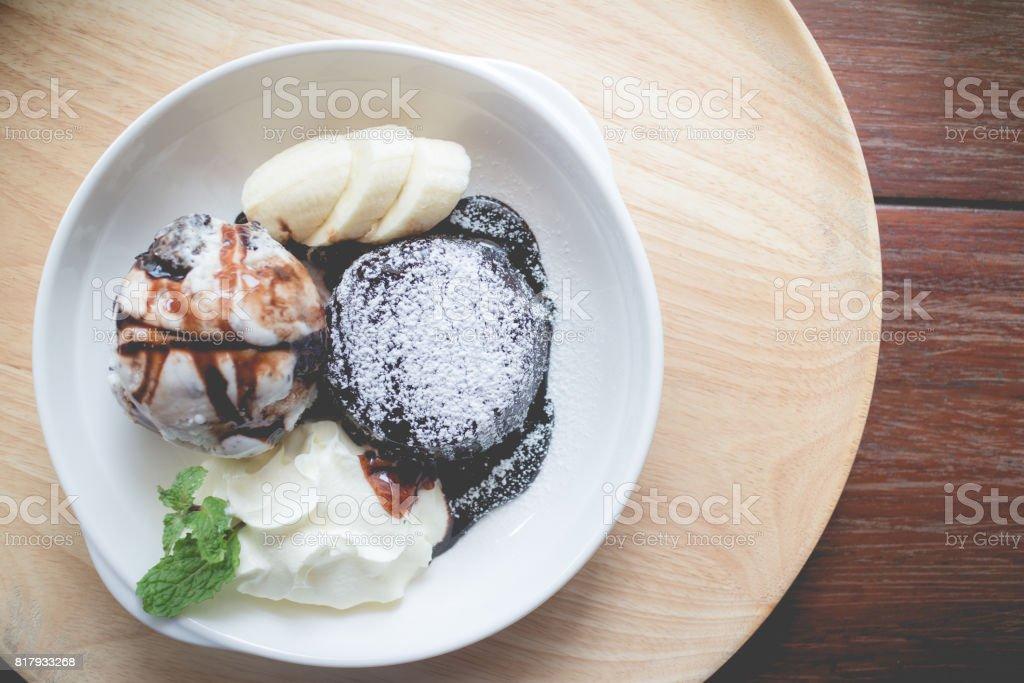 hot chocolate lava cake with vanilla ice cream ball, banana stock photo