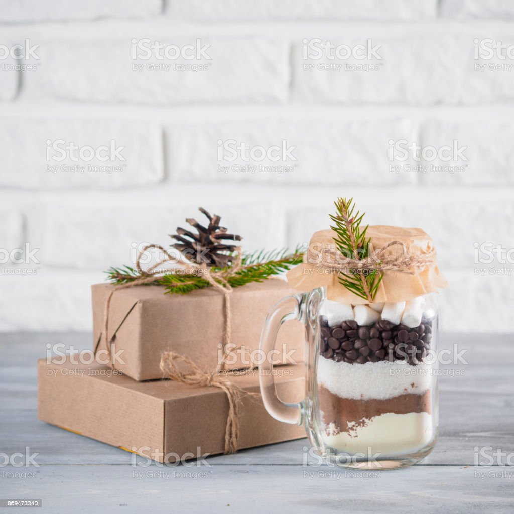 Hot chocolate mix in mason jar and gift boxes stock photo