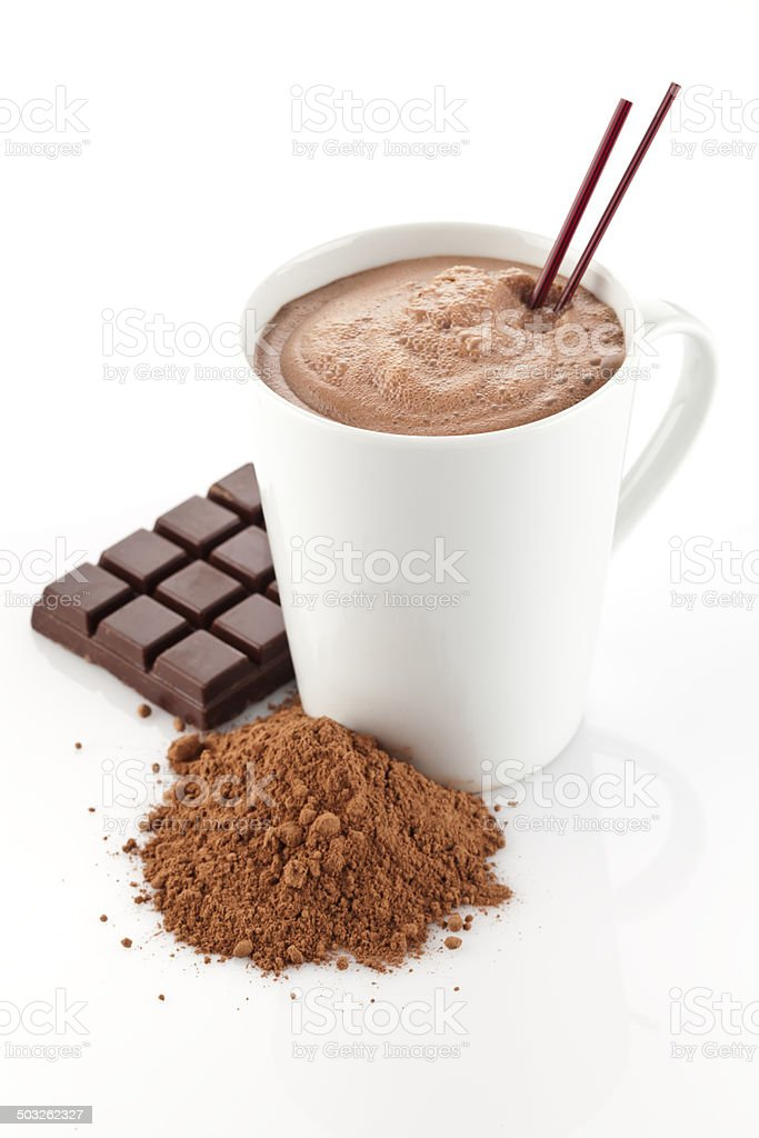Hot chocolate mug with ground cocoa and candy bar stock photo