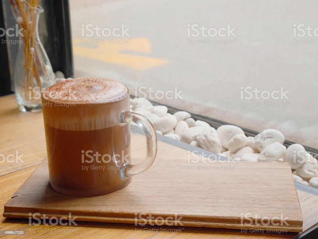 Hot chocolate on wooden tray stock photo