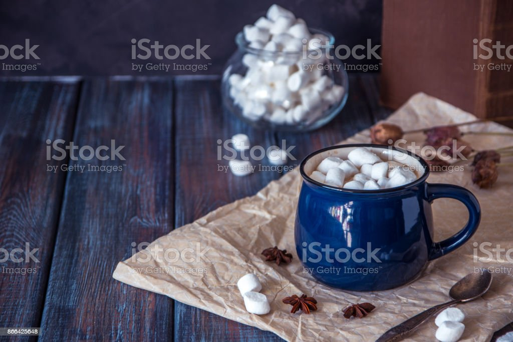 Hot chocolate or cacao in a blue mug with marshmallows stock photo