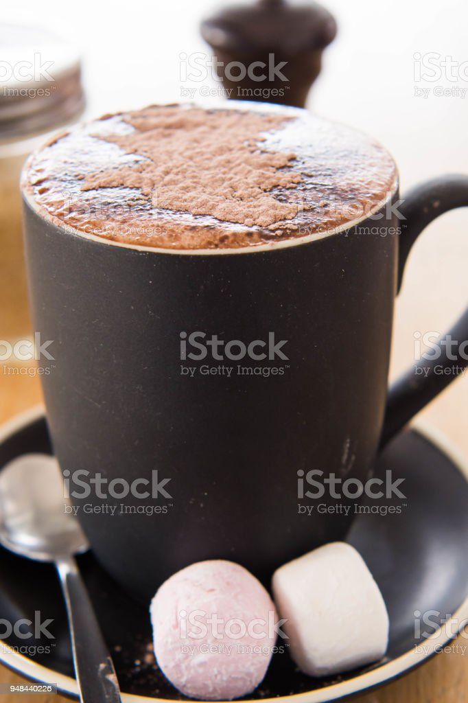 hot chocolate with big marshmallows on the side stock photo