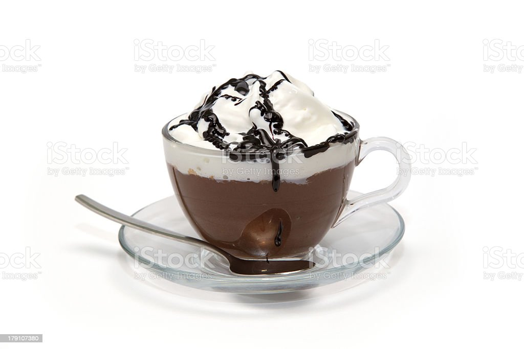 Hot chocolate with cream and syrup in glass cup stock photo