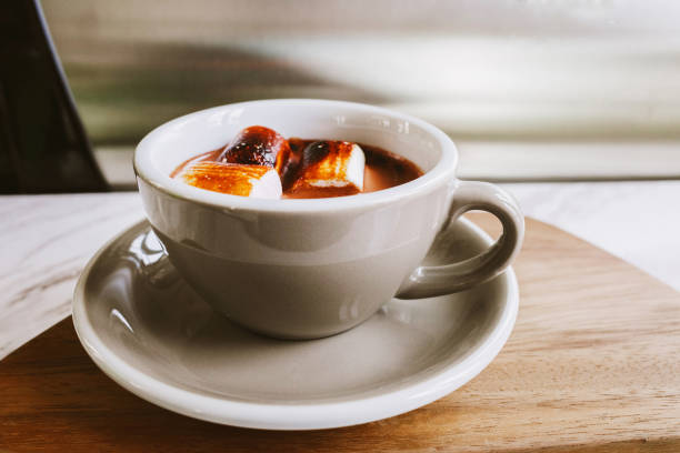 Hot Chocolate with Marshmallows in pastel mug stock photo