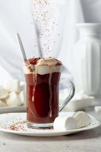 Hot chocolate with marshmallows sprinkled with chocolate crumbs. stock photo