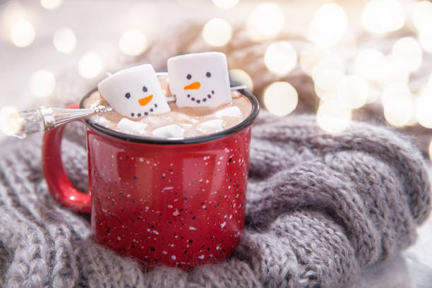 hot chocolate with melted snowman - hot chocolate stock photos and pictures