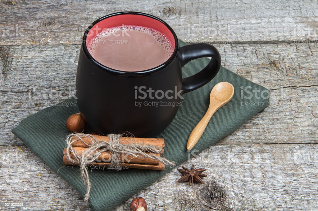 Hot chocolate with spices and nuts on  wooden background Lizenzfreies stock-foto