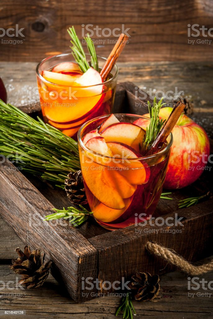 Hot cocktail with apple, rosemary, cinnamon stock photo