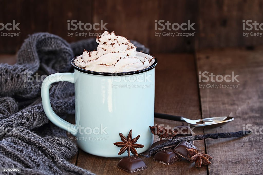 Enamel cup of hot cocoa or coffee for Christmas with whipped cream,...