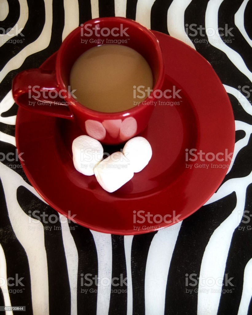 Hot cocoa with marshmallow in a red mug. stock photo