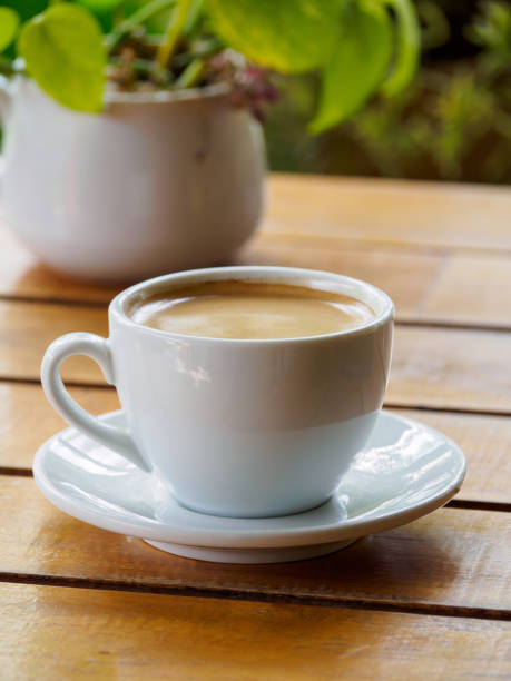 Hot coffee americano on the old wooden table stock photo