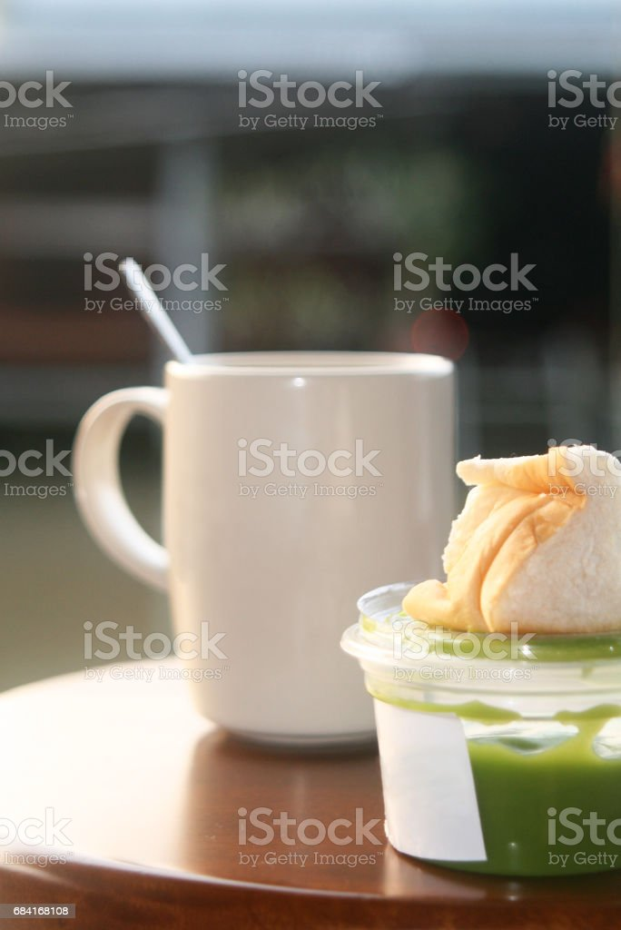 hot coffee and bread withpandan custard royalty-free stock photo