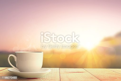 hot coffee and sunrise nature background